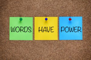 Words Have Power written on post-its on cork board