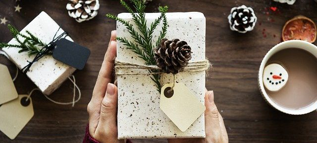 christmas gift box with pine cones and cup of coffee