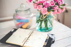 desk planner on table with flowers