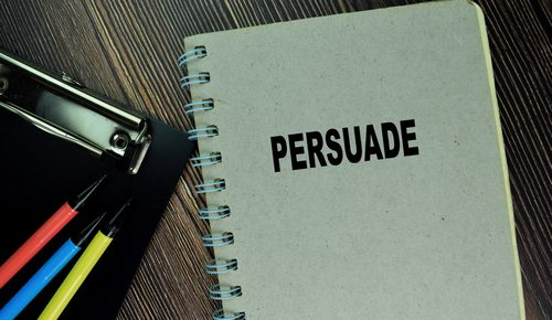 Notebook with 'persuade' on cover
